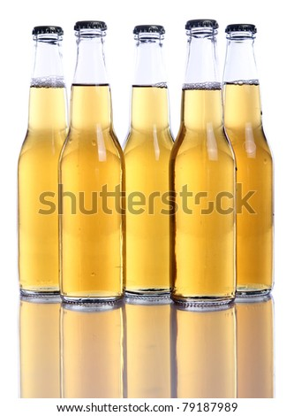 Bottles of cold and fresh beer over white background - stock photo