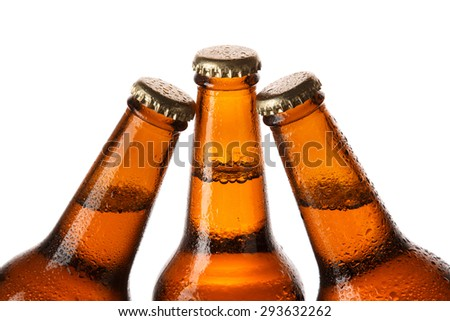 Bottles of cold beer on white background