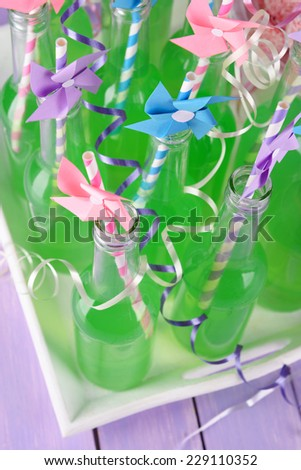 Bottles of drink with straw close up - stock photo