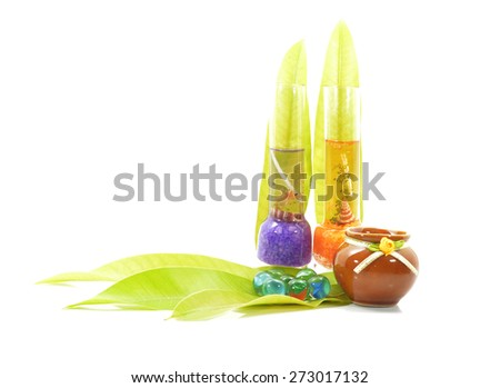 bottles of essential l and set of glass marble with leaves - stock photo