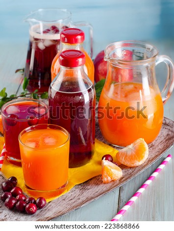 Bottles of Fresh juices on  wooden background. Selective focus - stock photo