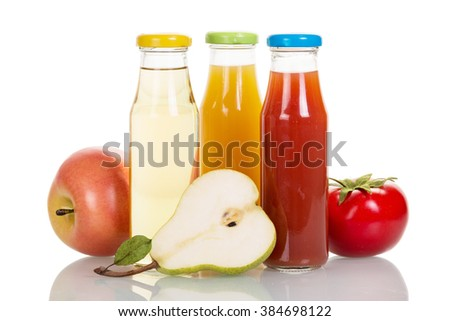 Bottles of fruit and vegetable juices isolated on white background. - stock photo