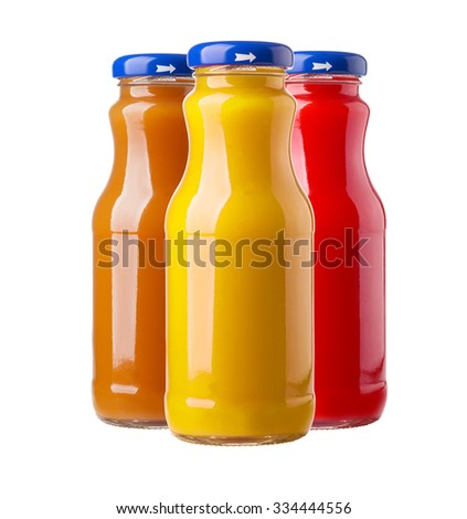 Bottles of fruit juice isolated on white background - stock photo