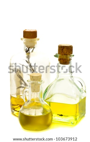 bottles of herbal and olive oil isolated on a white background