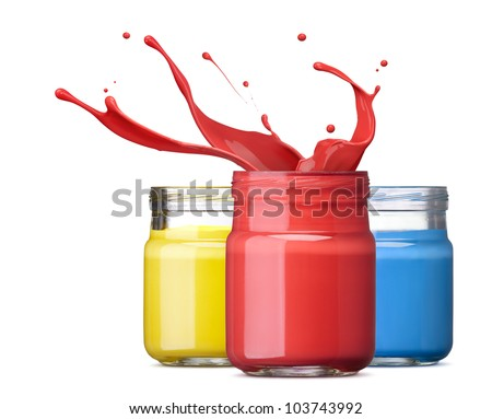 bottles of ink in primary colors, red with splash