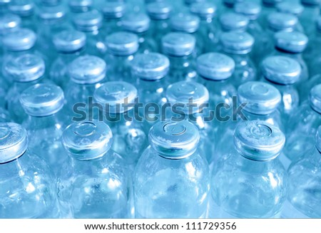 bottles of medicine in a row. - stock photo
