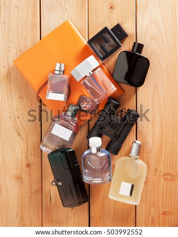 bottles of men perfumes with a notebook and binoculars in a beautiful composition