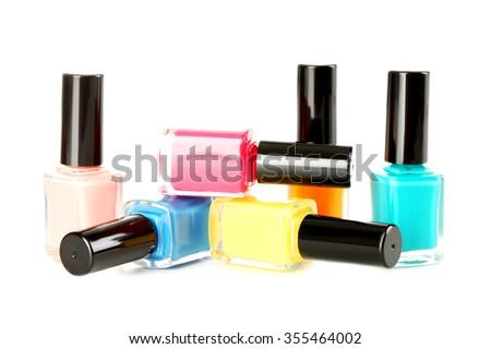 Bottles of nail polish isolated on a white - stock photo