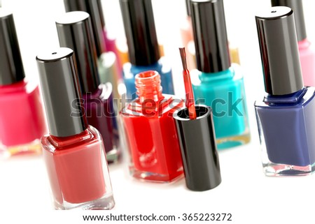 Bottles of nail polish on a white background - stock photo