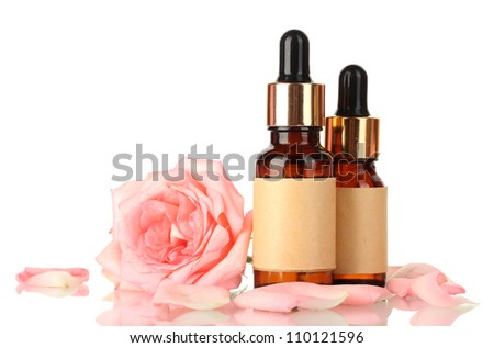 bottles of oil and rose isolated on white - stock photo