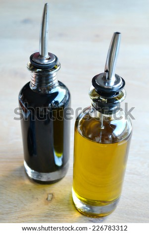 Bottles of olive oil and balsamic vinegar in the kitchen - stock photo