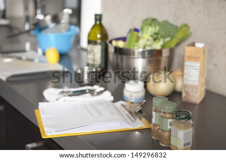Bottles of salad ingredients and seasonings on countertop at commercial kitchen - stock photo