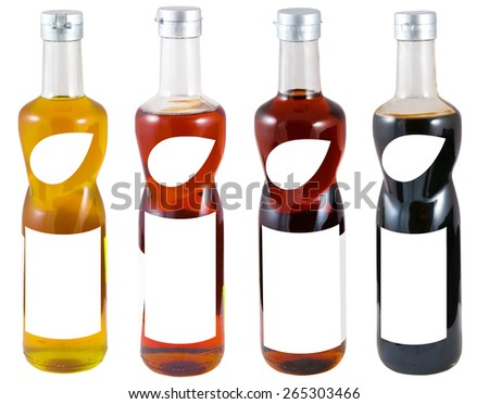 Bottles of sauces with blank label - stock photo