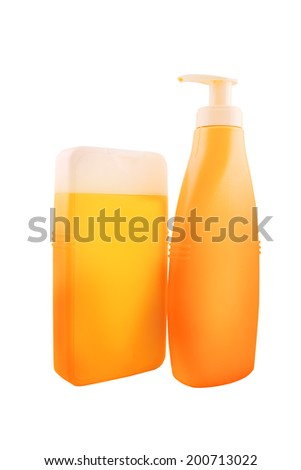 Bottles of sunbath oil or sunscreen isolated on white background with work path saved. - stock photo