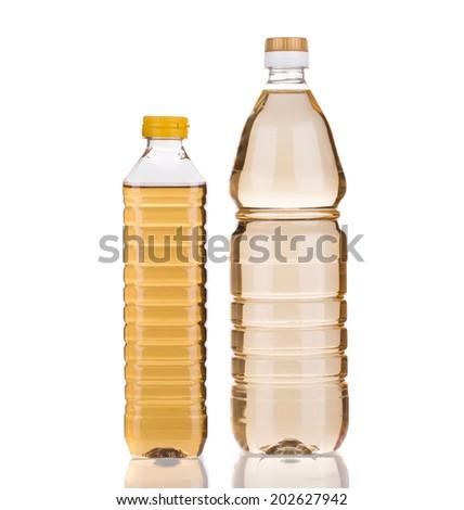 bottles of vinegar. Isolated on a white background. - stock photo