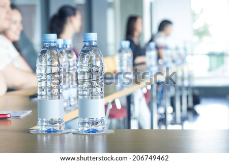 Bottles of water in conference room