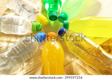Bottles of water on the wooden table - stock photo