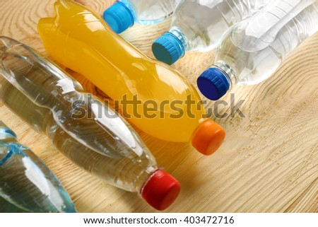 Bottles of water on the wooden table, close up