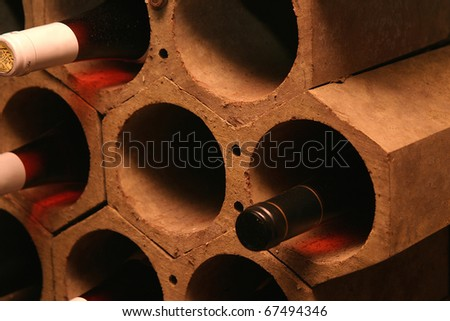 Bottles of wine in a cellar of a restaurant. - stock photo