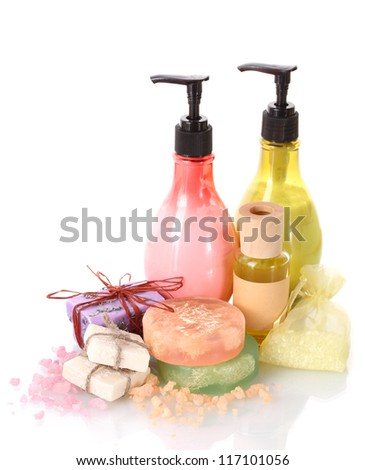 Bottles , soaps and sea salt isolated on white - stock photo