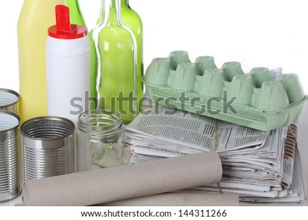 Bottles, tins and paper for recycling, closeup - stock photo