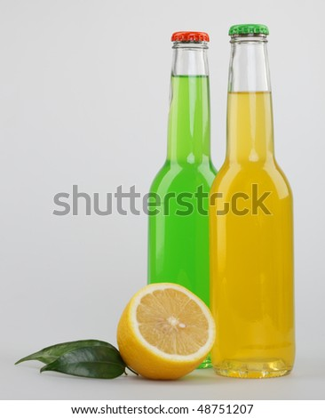 Bottles with drinks and a lemon share