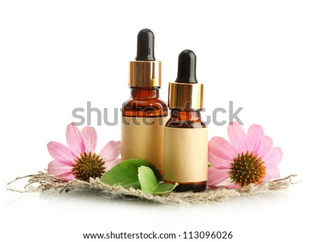 bottles with essence oil with purple echinacea , isolated on white - stock photo