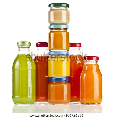Bottles with fruit berry juice  , baby food isolated on white - stock photo
