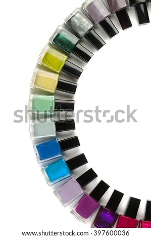 Bottles with nail polish arranged in a semicircle. Vertical frame. Isolate on white. - stock photo