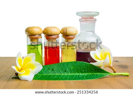 Bottles with natural aroma oil on white  - stock photo