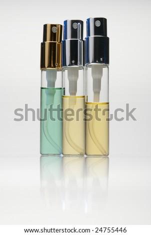 bottles with perfume isolated on white background - stock photo