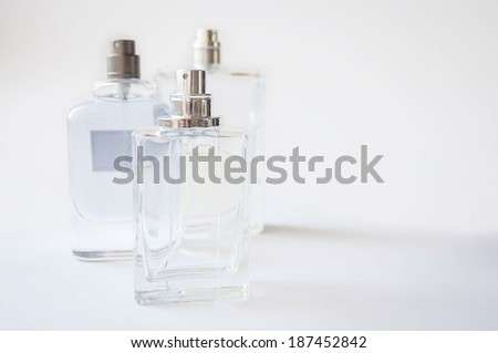 bottles with perfume on white background - stock photo