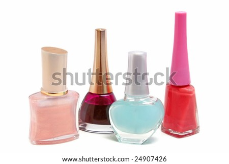 bottles with red nail polish isolated on white background