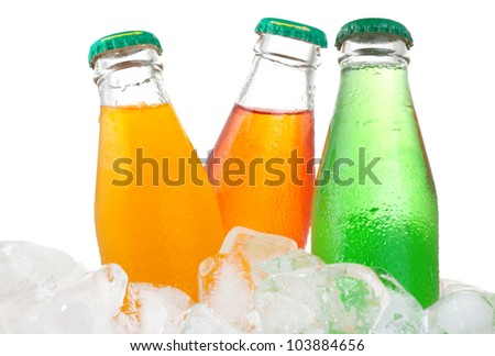 Bottles with soda in ice on white background - stock photo