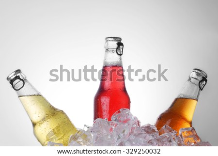 bottles with tasty drink in ice