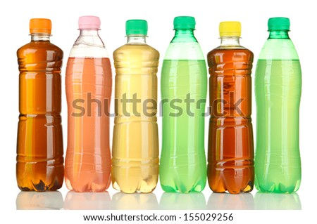 Bottles with tasty drinks, isolated on white - stock photo