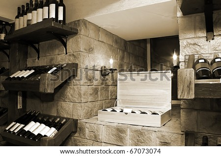Bottles with wine in a modern wine vault - stock photo