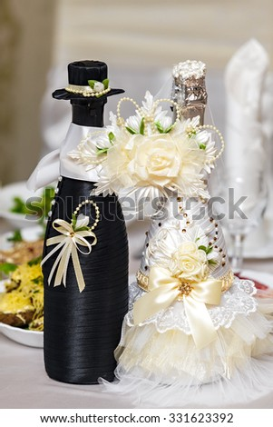 Bottles with wine on a wedding table - stock photo