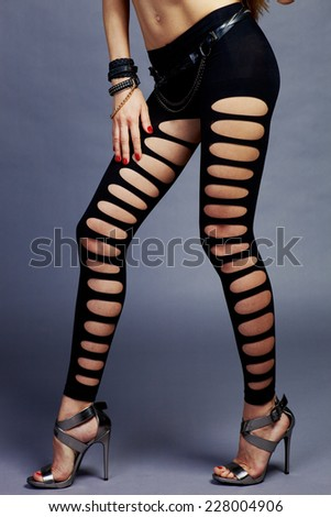 Bottom female models legs in sexual clothes in studio - stock photo