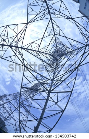 Bottom look up power transmission towers of sun sky
