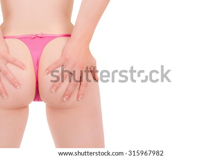 Bottom of an attractive woman in pink panties, closeup isolated in front of white studio background, photo with copy space on the right side of the image - stock photo