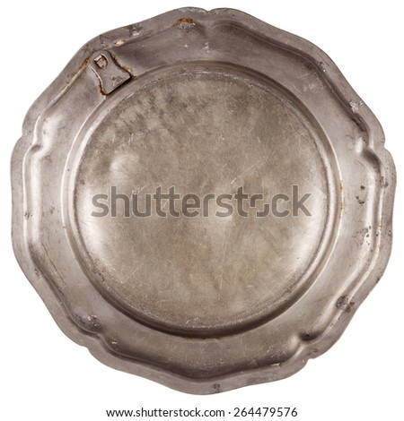 Bottom of old pewter plate isolated on white background   - stock photo