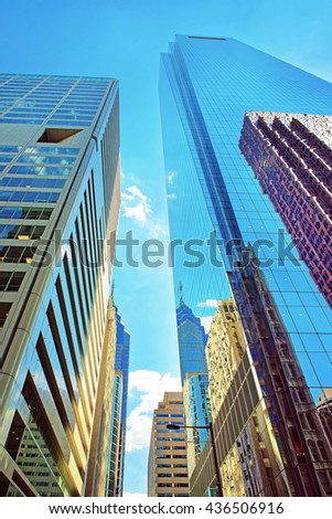 Bottom-up view to skyscrapers reflected in glass in Philadelphia, Pennsylvania, USA. It is central business district in Philadelphia - stock photo