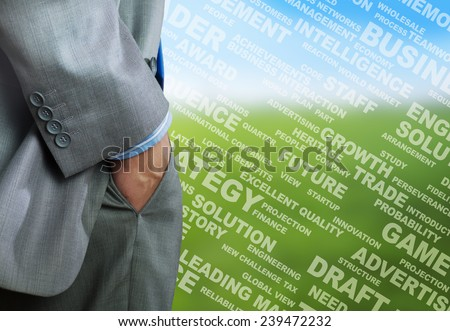 Bottom view of businessman with hands in pockets - stock photo
