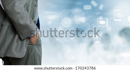 Bottom view of businessman with media images at background - stock photo