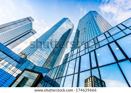 Bottom view of Deutsche Bank Twin Towers in the central business district of Frankfurt am Main, Germany. Frankfurt is the largest financial centre in Europe. - stock photo