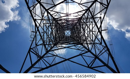 Bottom view of electric pole with beautiful blue sky.
