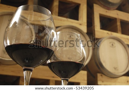 bottom view of glasses with red wine in a canteen - stock photo