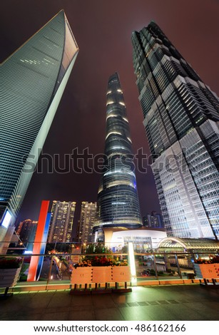 Bottom view of the Shanghai World Financial Center (SWFC), the Shanghai Tower and the Jin Mao Tower in downtown at night. Amazing view of skyscrapers in the Pudong New District (Lujiazui), China.