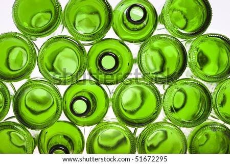 Bottoms of empty glass bottles on white background